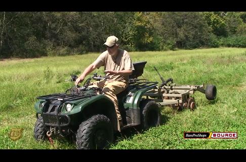 Semi - Permanent Food Plots using an ATV break the soil 2 of 5